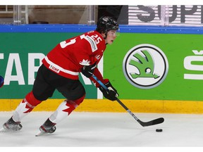 Team Canada defenceman Owen Power carries the puck during action at the IIHF World Championships in Riga, Latvia.