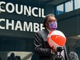 Mayor Naheed Nenshi holds a beach ball while speaking about Calgary's Canada Day program with media outside the Council Chamber on Wednesday, June 23, 2021.