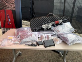 Red Deer RCMP seized a large amount of illicit drugs, weapons and stolen property after executing a search warrant in the community of Riverside Meadows.