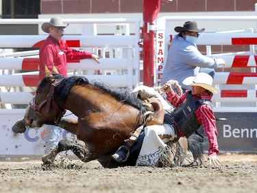Sage Newman from Melstonr, MT, riding Direct Delivery during the Saddle Bronc event on day 4 of the 2021 Calgary Stampede rodeo on Monday, July 12, 2021. Darren Makowichuk/Postmedia