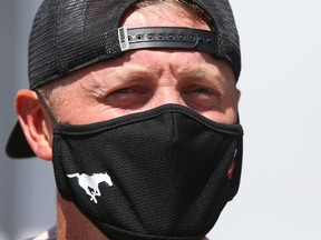 Calgary Stampeders QB Bo Levi Mitchell wears a team branded facemark as he leaves the CFL team's first training camp practice in Calgary on Saturday, July 10, 2021. Jim Wells/Postmedia