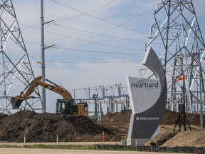A backhoe digs at the Inter Pipeline Heartland Petrochemical Complex under construction in Strathcona County, Alberta.