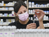 Barbara Violo, pharmacist and owner of The Junction Chemist Pharmacy, draws up a dose of the Pfizer-BioNTech COVID-19 vaccine, in Toronto, Friday, June 18, 2021.
