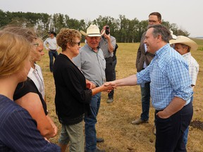 Alberta Premier Jason Kenny speaks with members of the Severtson family after announcing new drought support for Alberta ranchers and farmers. Friday, August 6, 2021. Dean Pilling/Postmedia