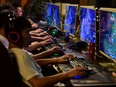 People play online games at an internet cafe in Fuyang, Anhui province, China.