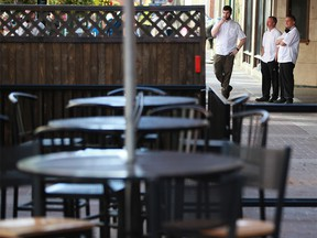 Hudsons pub chefs take a break along a quiet Stephen Avenue Mall over the lunch hour on Thursday, September 16, 2021. Alberta announced new COVID-19 restrictions which will affect restaurants starting on Sept 20.
