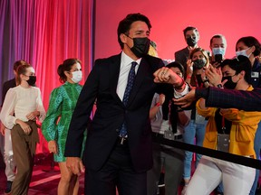 Prime Minister Justin Trudeau greets supporters during the Liberal election night party in Montreal early Tuesday morning, Sept. 21, 2021.