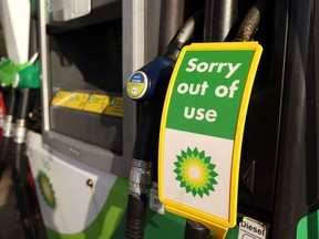 A sign reading 'Sorry out of use' on a diesel pump at BP Plc petrol station in Brentwood, U.K., last week. BP Plc, the second-largest fuel retailer in the U.K., said it's shutting some of gas stations because of a nationwide truck driver shortage that's threatening to derail the country's economic recovery.