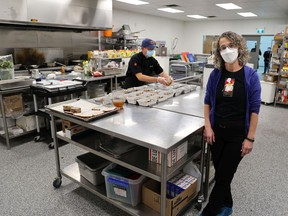 Devour Catering owner J'Val Shuster was photographed with chef Padma Adiwibawa as he prepared Thanksgiving dinners on Saturday, October 9, 2021. The catering company is working with Alberta Health Services to provide the Thanksgiving dinners for staff working in ICUs over the holiday weekend.