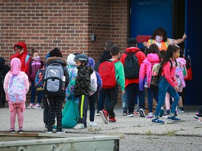 Kids head back to classes at Guy Weadick Elementary School in northeast Calgary on Wednesday, Sept. 1, 2021.