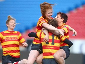Members of the Calgary Dinos Women's Rugby team celebrate in Calgary on  Sunday, October 22, 2017 after defeating the Victoria Vikes 26-21 in the Canada West final. Jim Wells/Postmedia  Postmedia Calgary Jim Wells, Jim Wells/Postmedia