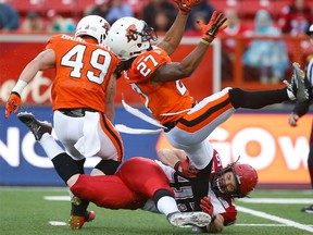 Calgary Stampeders special-teams star Charlie Power puts a hit on Darious Lane of the BC Lions during CFL action in Calgary, Alta.. on Friday June 12, 2015.