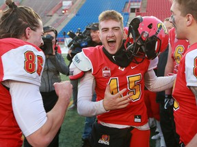 U of C Dinos kicker Niko Difonte celebrates after his 59-yard field-goal in the final seconds cinched the game over the UBC Thunderbirds 44-43.