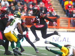 Stamps Tunde Adeleke (27) gets some air time during a return during the CFL Western Final in Calgary between the Calgary Stampeders and the Edmonton Eskimos on Sunday, November 19, 2017.  Jim Wells/Postmedia