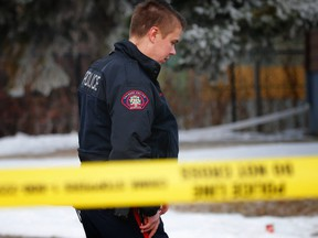Police investigate a suspected homicide at a home in Forest Lawn on Wednesday, November 15, 2017. Al Charest/Postmedia