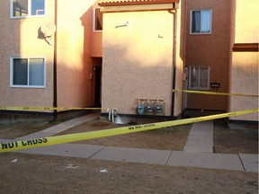 Police tape marks a unit in a Rundle condominium complex where Cory Lance Runner was fatally stabbed on Thursday December 7, 2017.