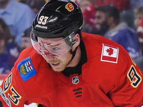 Sam Bennett of the Calgary Flames bleeds after taking a puck to the face at Scotiabank Saddledome on Nov. 28, 2017