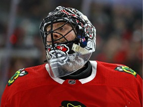 Jeff Glass of the Chicago Blackhawks rests during a break in the action against the Vegas Golden Knights at the United Center on Jan. 5, 2018 in Chicago.