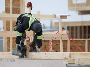 Construction workers build homes in the Mahogany area of southeast Calgary on Wednesday January 30, 2018. Gavin Young/Postmedia