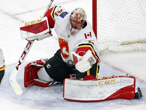 Calgary Flames goaltender Mike Smith (41) eyes the puck during the third period of an NHL hockey game against the Carolina Hurricanes, Sunday, Jan. 14, 2018, in Raleigh, N.C. (AP Photo/Karl B DeBlaker) ORG XMIT: NCKD114