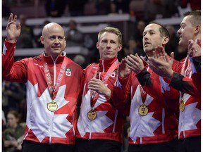 Team Koe skip Kevin Koe, left, waves after receiving his gold medal with third Marc Kennedy, second Brent Laing and lead Ben Hebert during the 2017 Roar of the Rings Canadian Olympic Curling Trials in Ottawa on Dec. 10, 2017. (File)
