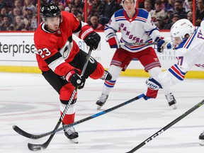 OTTAWA, ON - FEBRUARY 17:  Nick Shore #23 of the Ottawa Senators shoots the puck as Jesper Fast #17 of the New York Rangers makes a stick check in the second period at Canadian Tire Centre on February 17, 2018 in Ottawa, Ontario, Canada.  (Photo by Jana Chytilova/Freestyle Photography/Getty Images)