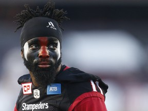 Calgary Stampeders safety Josh Bell is the team's new DB coach.