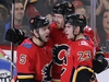 The Calgary Flames' Mark Giordano and Sean Monahan congratulate Dougie Hamilton after Hamilton scored on the the Florida Panthers during NHL action in Calgary on Saturday February 17, 2018. Gavin Young/Postmedia