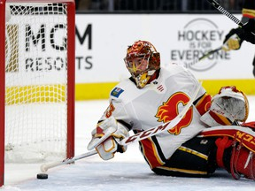 Calgary Flames goalie David Rittich clears the puck after a Vegas Golden Knights goal during the first period of an NHL hockey game Wednesday, Feb. 21, 2018, in Las Vegas.