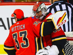 Calgary Flames goaltender Jon Gillies celebrates with teammate David Rittich after a 5-1 victory over the Colorado Avalanche during NHL hockey at the Scotiabank Saddledome in Calgary on Saturday, February 24, 2018.