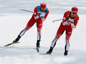 PYEONGCHANG-GUN, SOUTH KOREA - MARCH 12:  Brian McKeever  and his guide Graham Nishikawa of Canada compete in the Men's Cross Country 20km Free, Visually Impaired event at Alpensia Biathlon Centre during day two of the PyeongChang 2018 Paralympic Games on March 12, 2018 in Pyeongchang-gun, South Korea. (Photo by Buda Mendes/Getty Images)