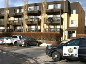 Calgary police hold the scene at an apartment building at 3500 block of 49 St N.W. in Calgary on Wednesday, March 28, 2018.