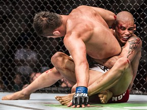 Kajan Johnson (right) holds on to Tae Hyun Bang during a UFC 174 lightweight bout at Rogers Arena in Vancouver, B.C. on Saturday, June 14, 2014. (Postmedia file photo)