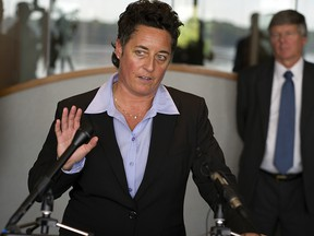In this Sept. 28, 2015, file photo, former University of Minnesota Duluth women's hockey coach Shannon Miller speaks about the discrimination lawsuit she and two other female coaches have filed against the school, at the law offices of Fafinski Mark & Johnson in Eden Prairie, Minn. (Richard Tsong-Taatarii/Star Tribune via AP, File)