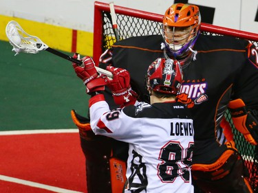 The Calgary Roughnecks' Riley Loewen lines up a shot on Buffalo Bandits goaltender Alex Buque during a National Lacrosse League game in Calgary on Saturday April 14, 2018.
