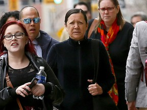 Elmarie Simons (centre) walks into Calgary Courts to be sentenced for criminal negligence in the 2015 death of 18-month-old girl Ceira McGrath.