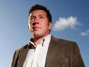 Former NHL player Sheldon Kennedy stands on a hillside overlooking Calgary on October 9.