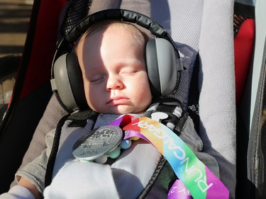 Three-month-old Finley Newman showed off his dad Devin's finisher medal after cruising and snoozing in his stroller through the Jugo Juice 10 KM event at the Scotiabank Calgary Marathon at Stampede Park on Sunday May 27, 2018.