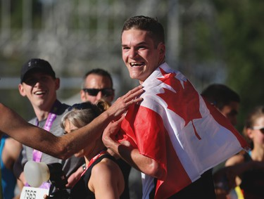 Calgary's Trevor Hofbauer was all smiles after winning the Centaur Subaru Half Marathon event at the Scotiabank Calgary Marathon at Stampede Park on Sunday May 27, 2018.