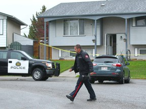Calgary police attend a crime scene on Penbrooke Cl SE in Calgary on Thursday, May 17, 2018. A witness was told by police that shots were fired by police.
