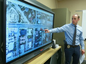 Const. Paul Teworte, a member of the Calgary Police Online Stolen Property Team reviews a city map and confirms a target address in the Beltline and containment by marked police units on Thursday, June 14, 2018 before joining the team and executing a search warrant later in the day. The specialized unit is the only team in Canada dedicated to researching and recovering many different types of property bought and sold online and they work closely with the Break and Enter Team. Jim Wells/Postmedia