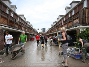 Residents and volunteers clear flood damage in  Erlton in the weeks after the 2013 flood.