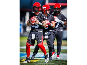Calgary Stampeders Bo Levi Mitchell, Nick Arbuckle and Larry Brihm during practice on Monday, July 16, 2018. Al Charest/Postmedia