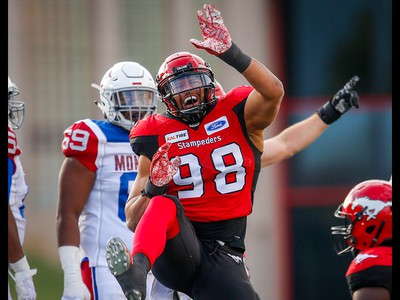 Calgary Stampeders James Vaughters celebrates after a sack on quarterback Matthew Shiltz of the Montreal Alouettesduring CFL football in Calgary on Saturday, July 21, 2018.
