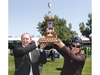 Kevin Burgenmeister (L) Director Thermal Operations, Electric Generation, ATCO joins winner Eric Lamaze (CAN) in hoisting the ATCO Cup at the Spruce Meadows North American in Calgary, AB on Thursday, July 5, 2018. Lamaze won in a jump-off. Jim Wells/Postmedia