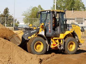 Police say a front end loader (not the one pictured) was reported stolen from a worksite in the area of61stStreet and 100 Avenue S.E. on Monday. It was spotted two days later and the thief was chased down by contractors from a nearby construction site.
