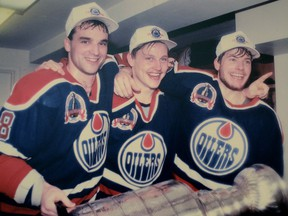 """May 24, 1990. Nicknamed after the 1929 to 1936 Toronto Maple Leafs threesome the Edmonton Oilers, 1990 Stanley Cup play-off champions, """"Kid-line"""" left to right, consisted of 21-year olds Joe Murphy, Adam Graves and 19-year-old Martin Gelinas celebrate their win in the Oilers dressing room on May 24, 1990 after the Oilers beat the Boston Bruins in five games. Photo Supplied/Family"""