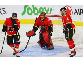 Calgary Flames T.J. Brodie, goaltender Mike Smith and Mark Giordano react after giving up a goal to C.J. Suess of the Winnipeg Jets during NHL pre-season hockey at the Scotiabank Saddledome in Calgary on Monday, September 24, 2018. Al Charest/Postmedia