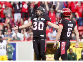 Rene Paredes and Rob Maver of the Calgary Stampeders.