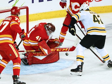 Calgary Flames goaltender Mike Smith stops this shot in front of the Boston Bruins' David Backes during NHL action at the Scotiabank Saddledome in Calgary on Wednesday October 17, 2018.